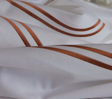 Bespoke Satin Stitch on a bed styled by Natasha Lockwood